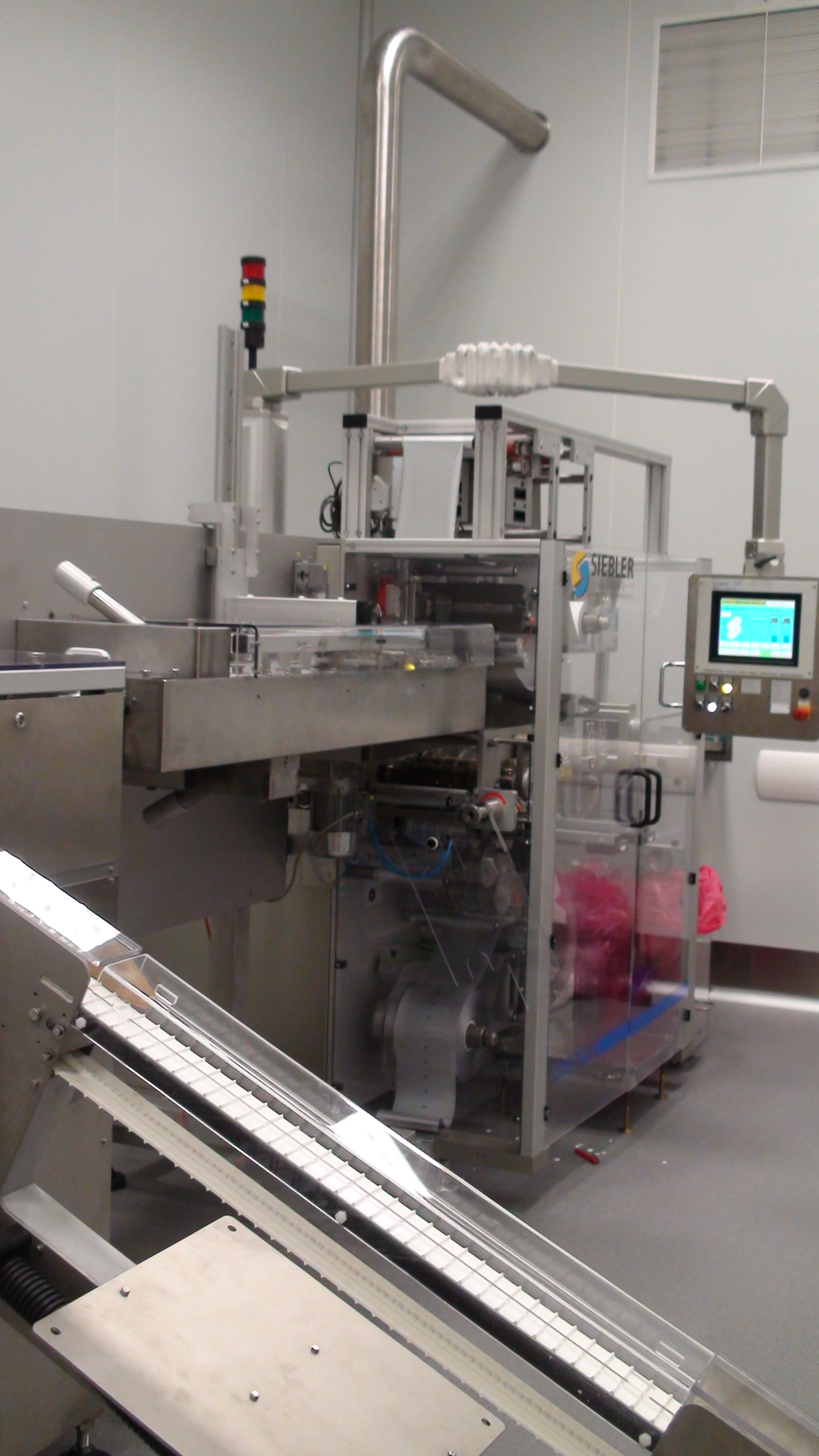 Siebler + Göring Vertical packaging machine for strips with 4-sided sealing for effervescent tablets HM2/160E